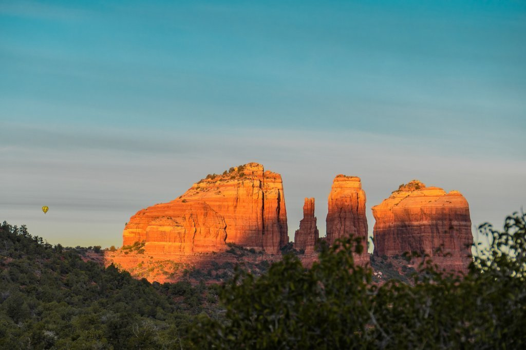 Sedona photo tour including a photo of a morning sunrise view of Cathedral Rock in Sedona, AZ with yellow hot air balloon
