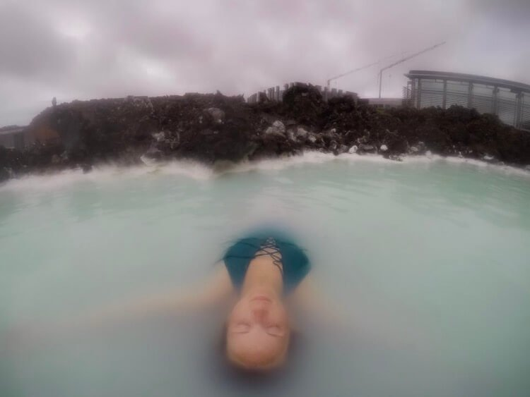 Girl floating in the Blue Lagoon in Iceland