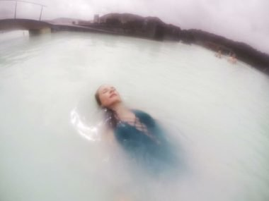 Girl floating in Blue Lagoon Iceland