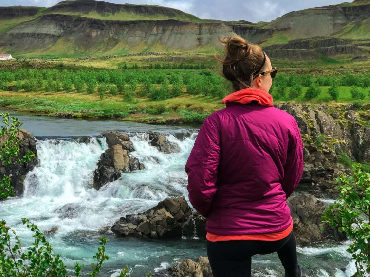 the scenery of Iceland with waterfalls and volcanoes in background