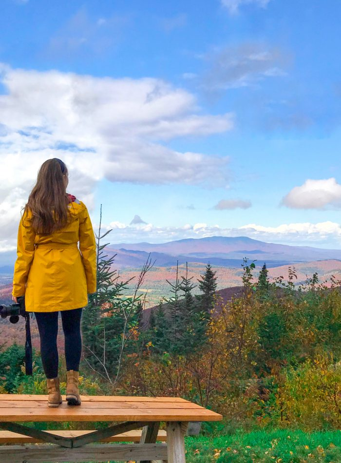Girl looking over the fall foliage along scenic memorial highway in Lake Placid New York